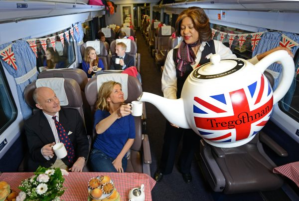 Passengers on board a First Great Western train from Paddington to Cornwall this morning were treated to a quintessentially English tea party complete with the world's largest fully-functioning tea pot, which brews over 300 cups. The tea party marks the availability of Britain's first and only tea – Tregothnan - on the rail provider's services.
