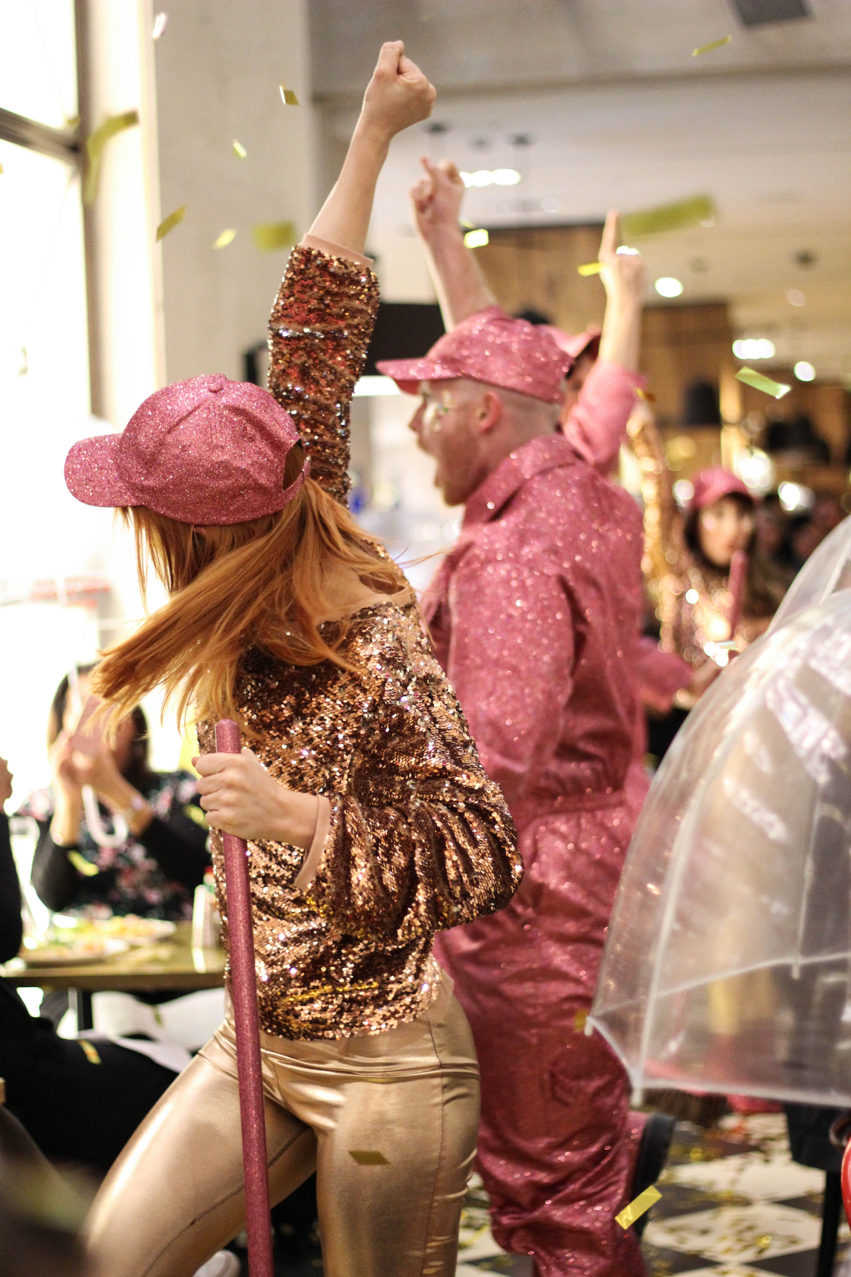 A pair of disco dancers wearing pink and gold sequin costumes entertain guests for Selfridges Christmas Entertainment