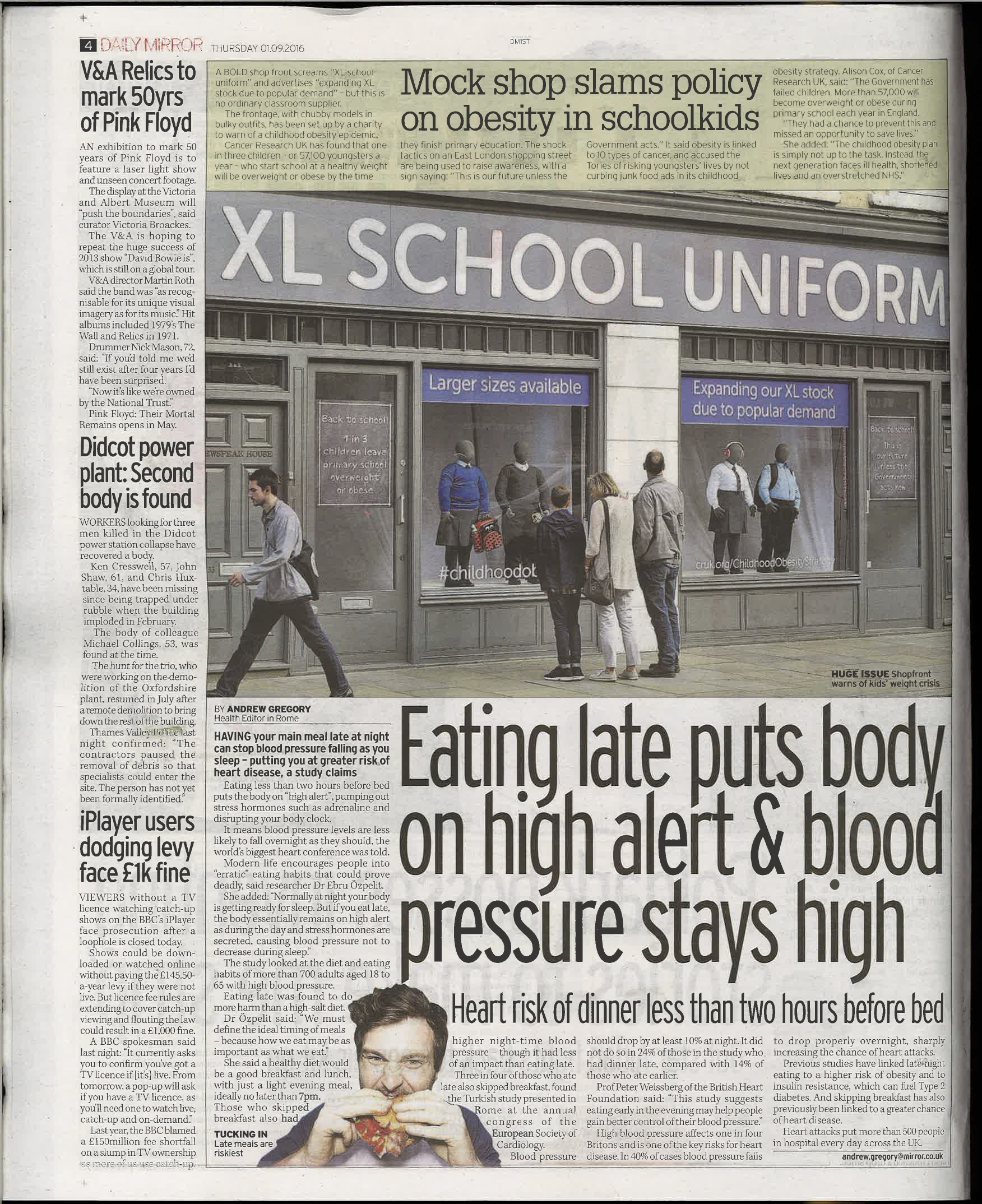 An article in the Daily Mirror including a photograph of a window display containing obese mannequins in tight school uniform
