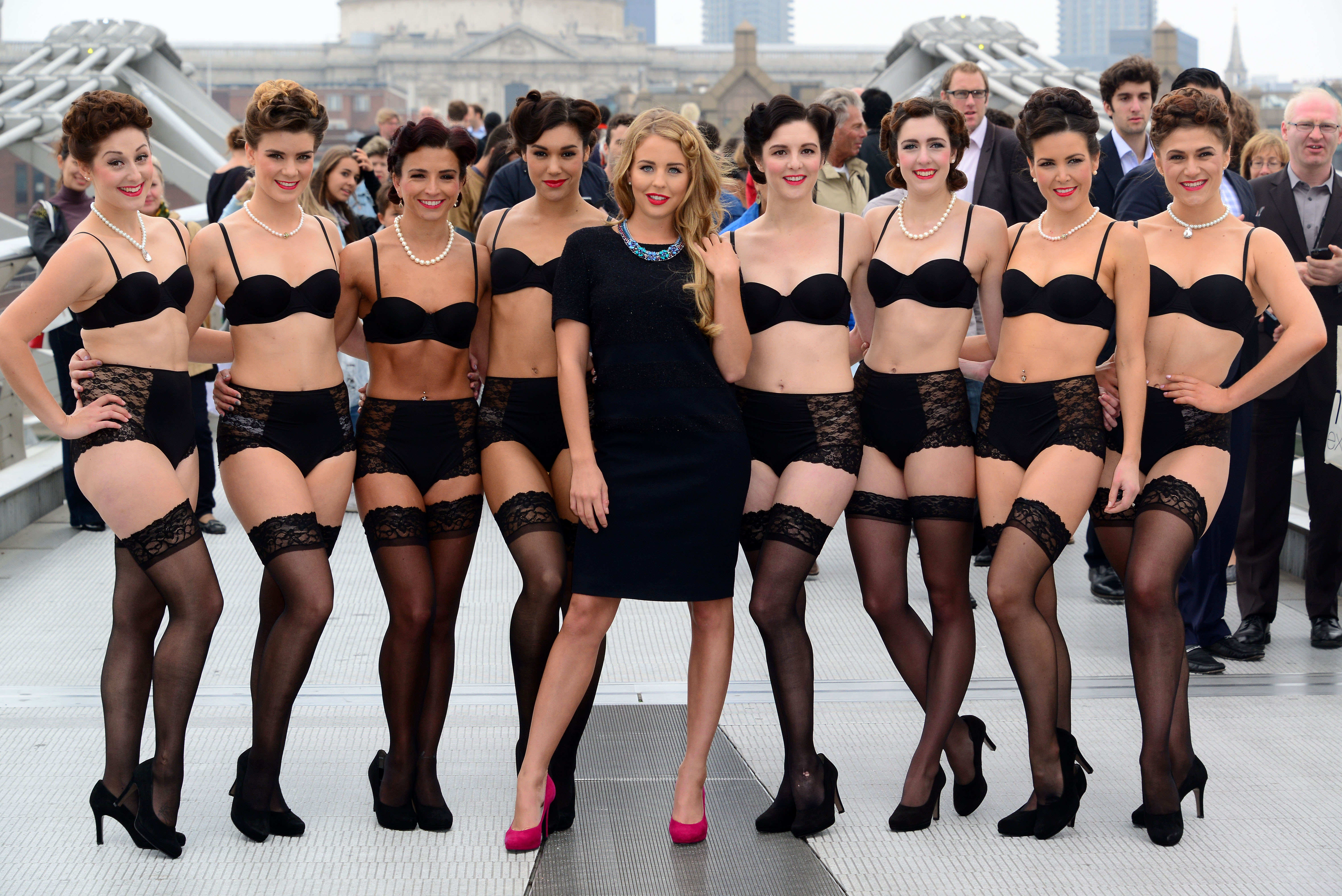 group of dancers in underwear pose with TOWIE star Lydia Bright