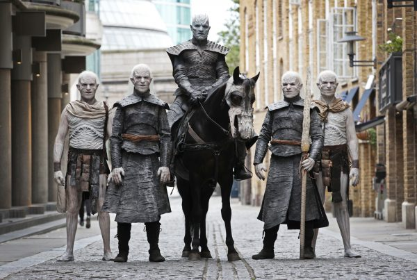 Five models dressed as 'White Walkers' from Game of Thrones, led by the 'Night King' on horseback, walk through the streets of London