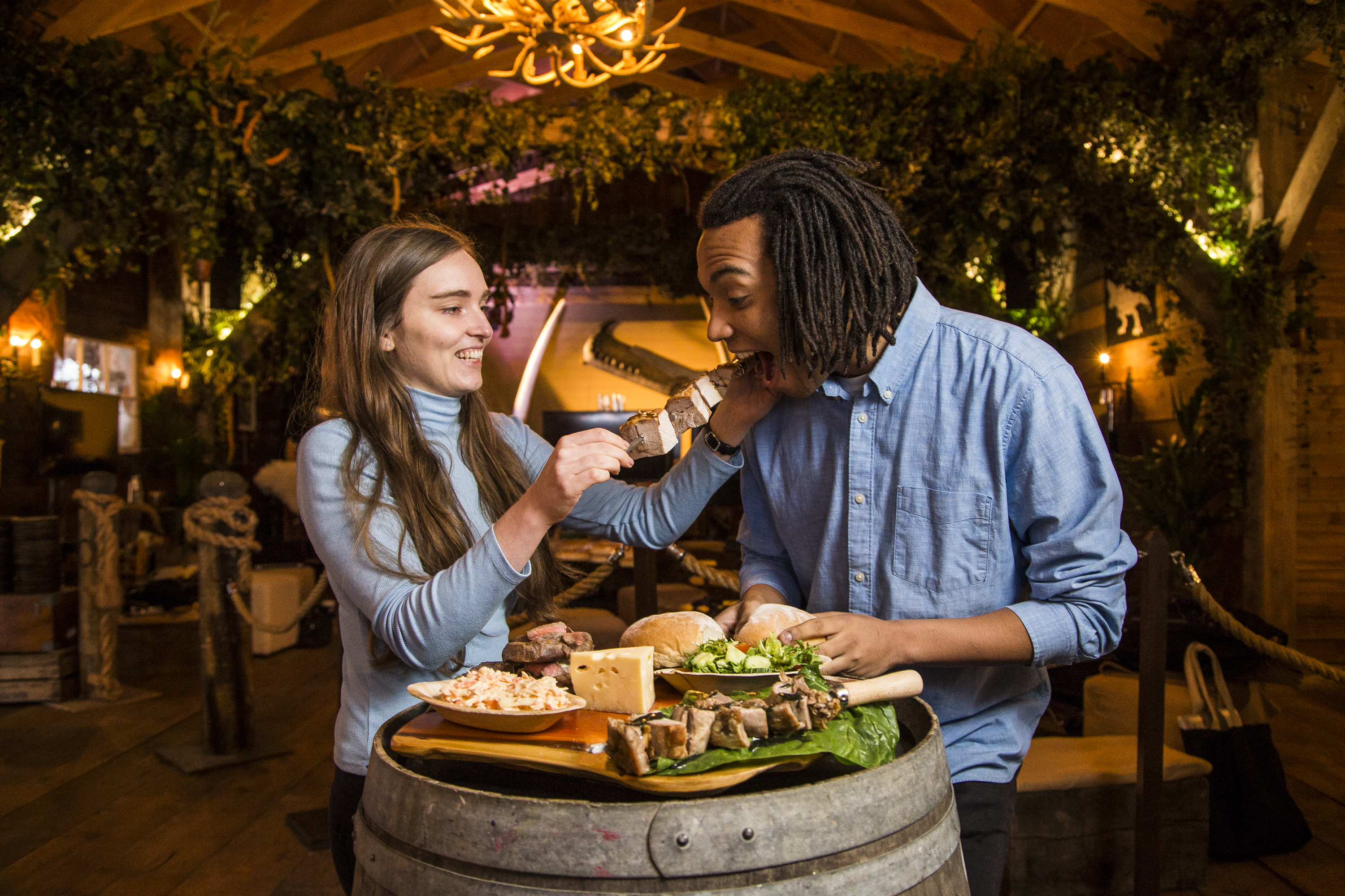 A couple enjoy the food at a restaurant pop-up in London called the Monster Hunter Meat Shack to celebrate the release of upcoming Capcom video game 'Monster Hunter: World'.