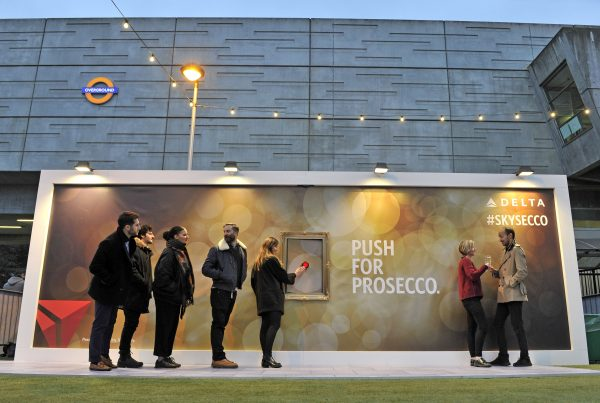People queue for a glass of Prosecco from the giant interactive billboard we made for Delta Airlines. The pop-up experiential PR stunt was designed to celebrate being the first airline to offer Prosecco as part of their standard service in the main cabin.