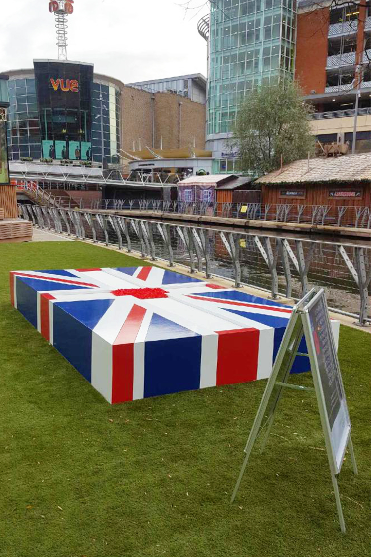 An interactive union jack PR stunt installation allowing members of the public to pay their respects by filling in the middle section of the flag with poppies
