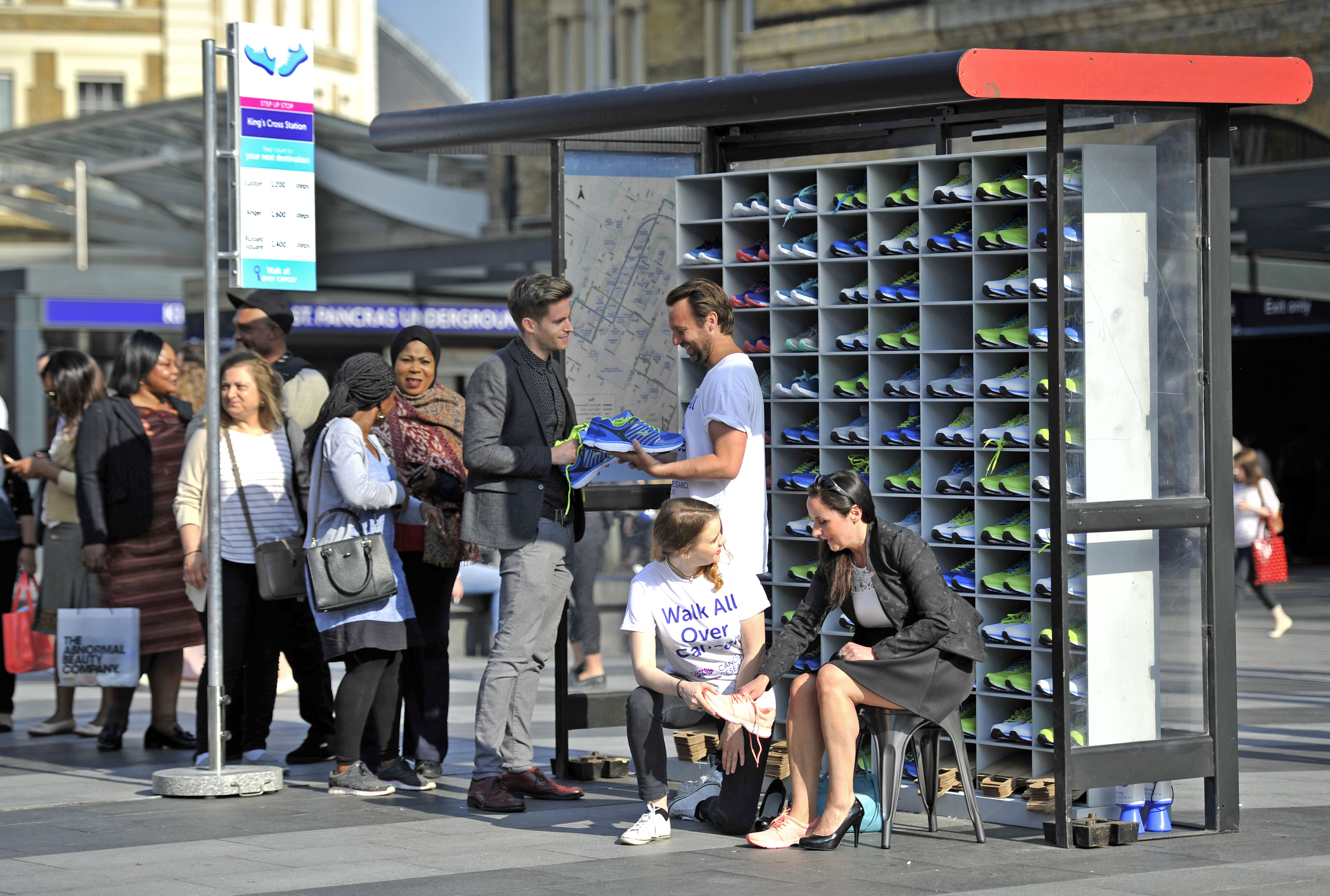 CRUK Cancer Research Walk All Over Cancer PR Stunt Kings Cross Bus stop Bespoke Installation Experiential event Campaign