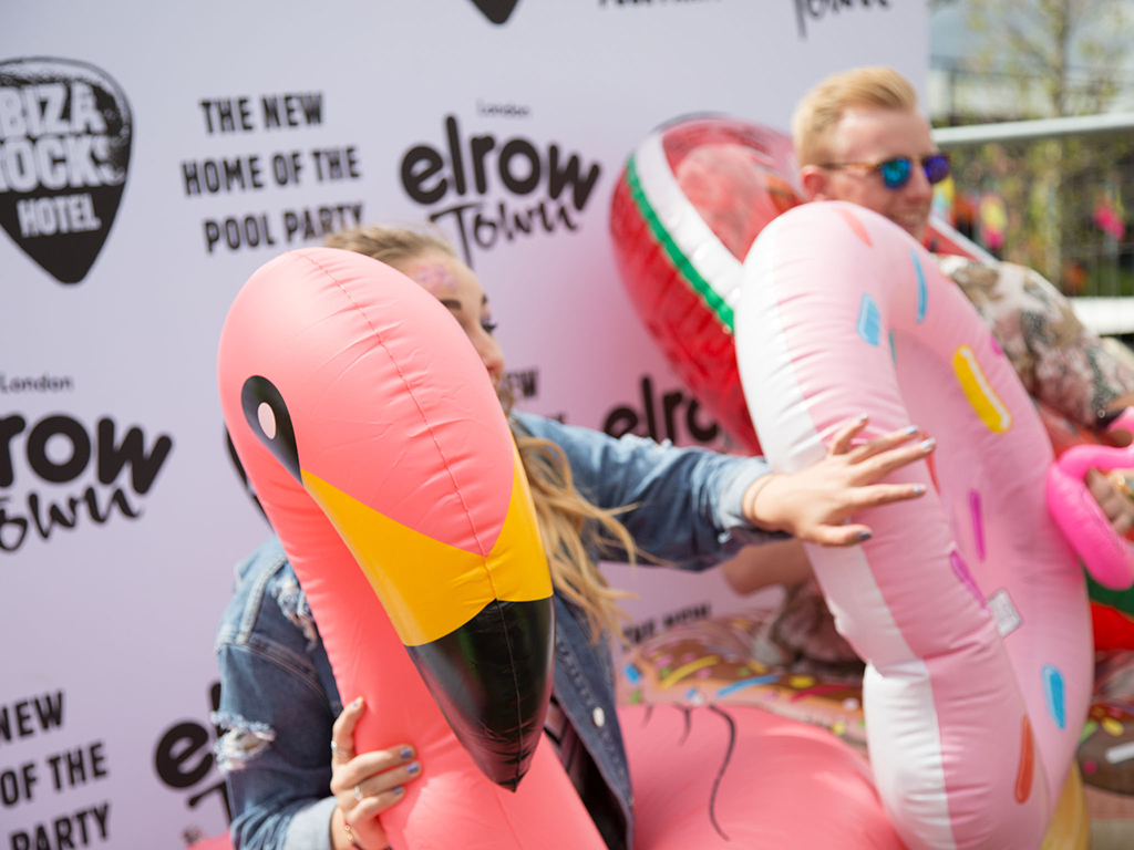 Party goers pose for photos with inflatable props