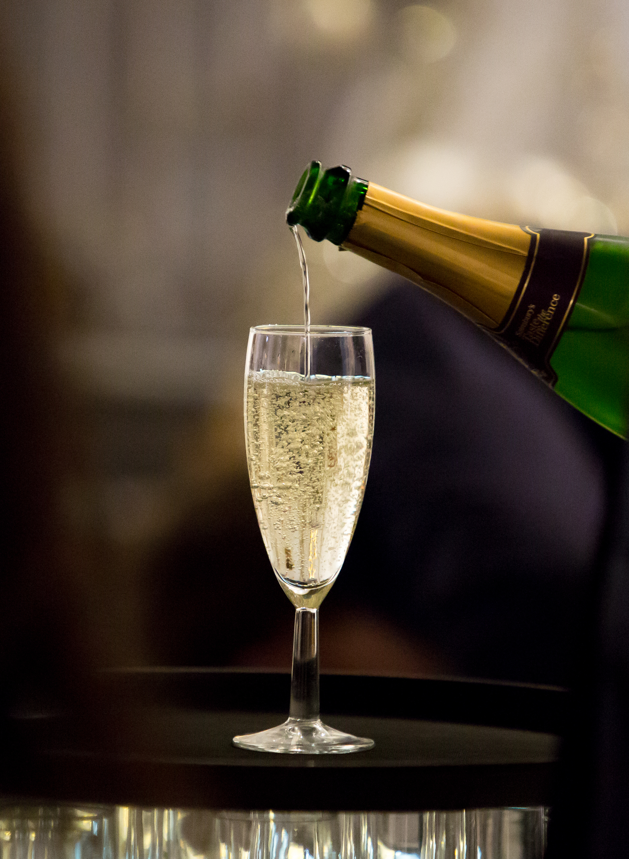 Pouring bubbly at Sainsbury's Festive Fizz Bar Pop-Up