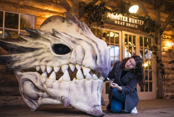 Artist adds the finishing touches to a restaurant pop-up in London called the Monster Hunter Meat Shack to celebrate the release of upcoming Capcom video game 'Monster Hunter: World'.