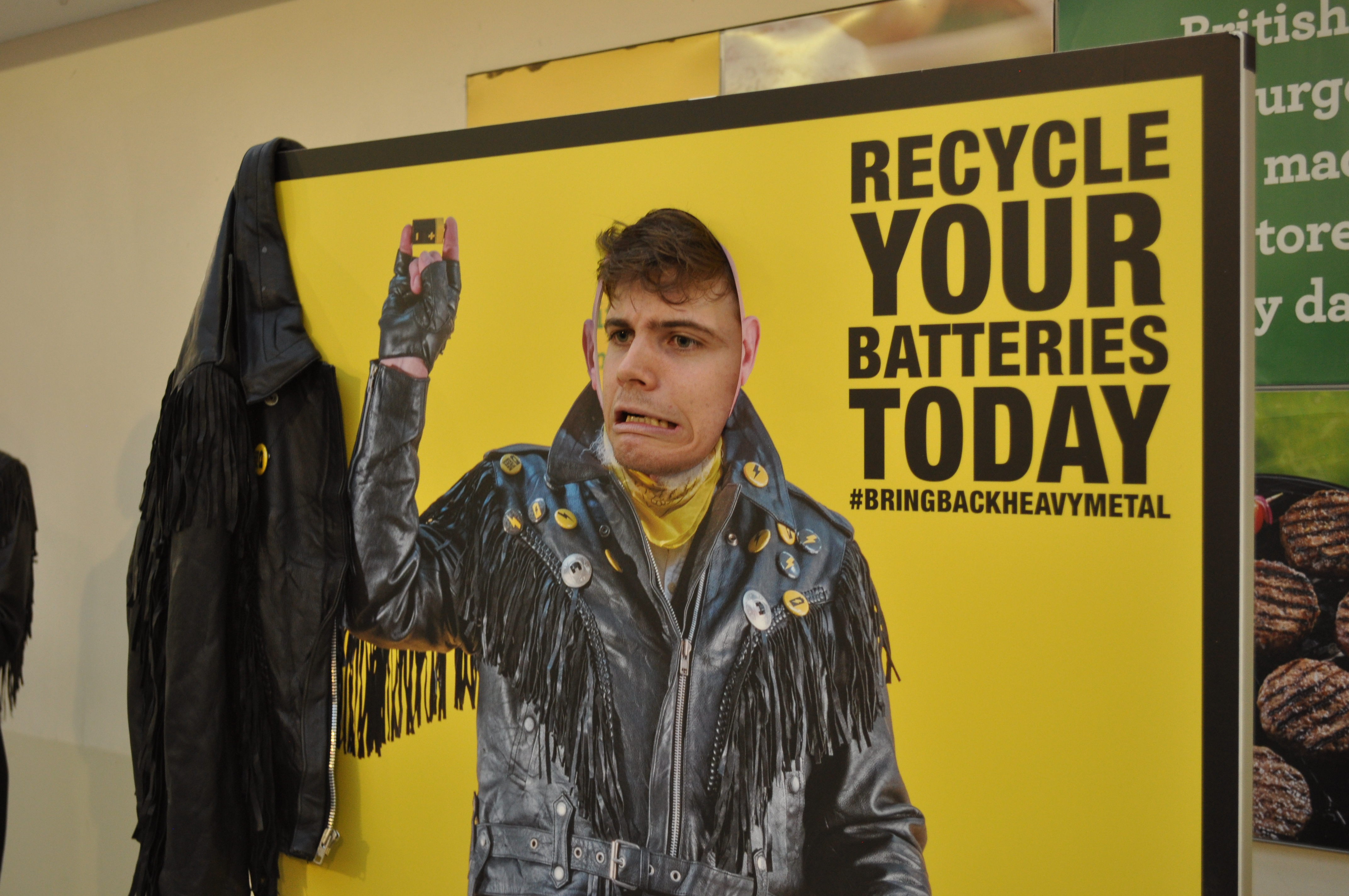 Member of the public poses for photo to promote recycling batteries.