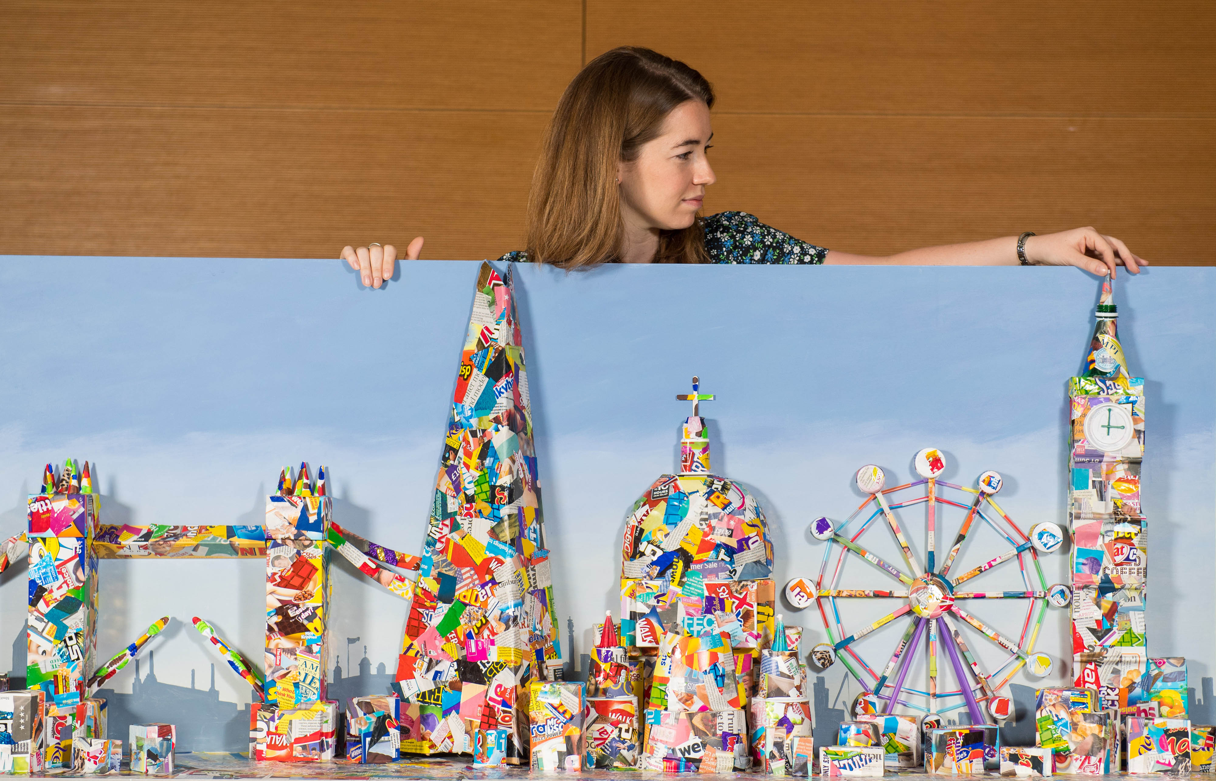 Laura Jackson views an artwork showing the London skyline created entirely from recycled litter at the Museum of London as part of The City is Ours exhibition, which explores both the joys and frustrations of city life. PRESS ASSOCIATION. Picture date: Tuesday August 22 2017. On until 2 January 2018, the interactive exhibition ponders what the future holds for London and tackles issues such as population growth, recycling, air quality, transport, green spaces and what we as citizens can do to make our cities more sustainable. Photo credit should read: Dominic Lipinski/PA Wire