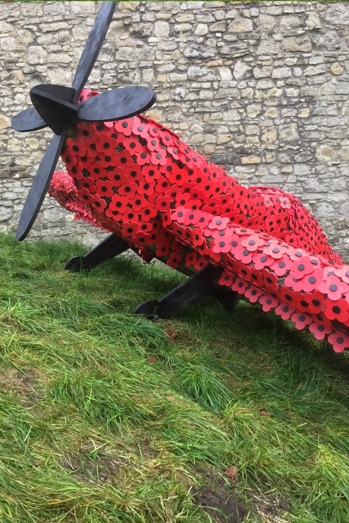 A full size spit fire covered in poppies for remembrance day